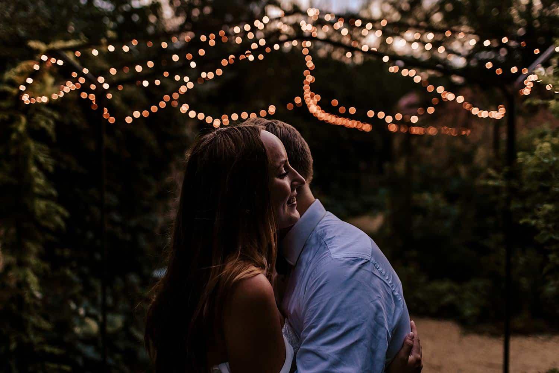 Brautpaar portraits twinkle lights,